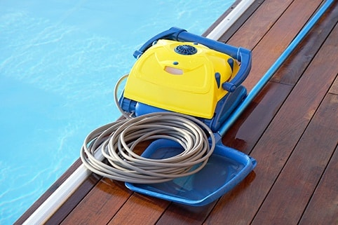 Pool Cleaner Next to the Pool